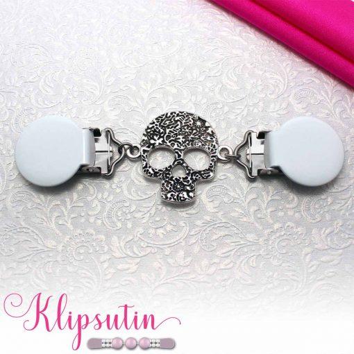 Napittoman neuletakin ja villatakin pidike nimeltä Klipsutin Gallo. Kuvassa näkyy tuotteen valkoinen vaihtoehto.