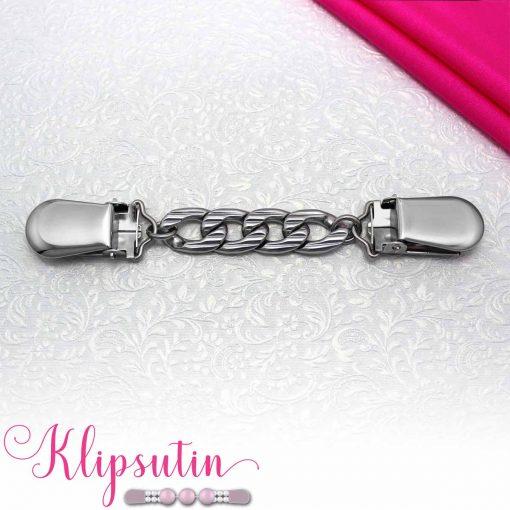 Napittoman neuletakin ja villatakin pidike nimeltä Klipsutin Kaski. Kuvassa näkyy tuotteen hopeanvärinen vaihtoehto.