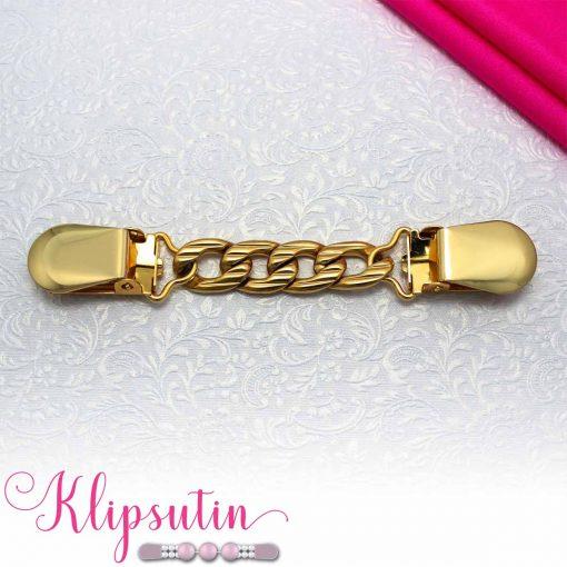 Napittoman neuletakin ja villatakin pidike nimeltä Klipsutin Kaski. Kuvassa näkyy tuotteen kullanvärinen vaihtoehto.