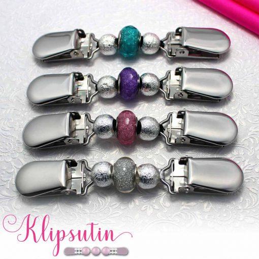 Napittoman neuletakin ja villatakin pidike nimeltä Klipsutin Tuiti. Kuvassa näkyy tuotteen kaikki vaihtoehdot.