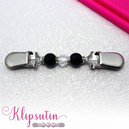 Napittoman neuletakin ja villatakin pidike nimeltä Klipsutin Tania. Kuvassa näkyy tuotteen musta vaihtoehto.