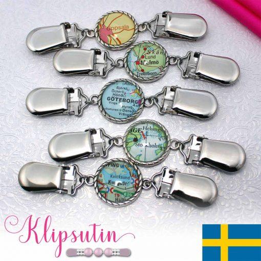 Napittoman neuletakin ja villatakin pidike nimeltä Klipsutin Karttaset Ruotsi.