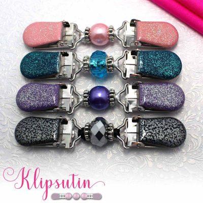 Napittoman neuletakin ja villatakin pidike nimeltä Klipsutin Salla. Kuvassa näkyy tuotteen kaikki vaihtoehdot.