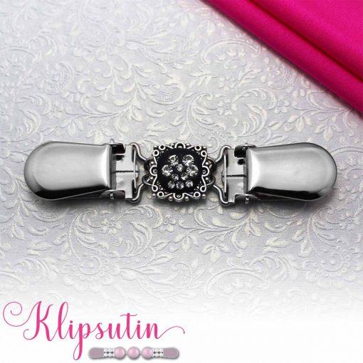 Napittoman neuletakin ja villatakin pidike nimeltä Klipsutin Kristallitassu. Kuvassa näkyy tuotteen kirkas vaihtoehto.