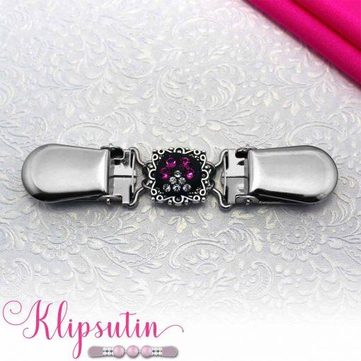 Napittoman neuletakin ja villatakin pidike nimeltä Klipsutin Kristallitassu. Kuvassa näkyy tuotteen pinkki vaihtoehto.