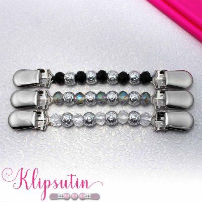 Napittoman neuletakin ja villatakin pidike nimeltä Klipsutin Line. Kuvassa näkyy tuotteen kaikki vaihtoehdot.